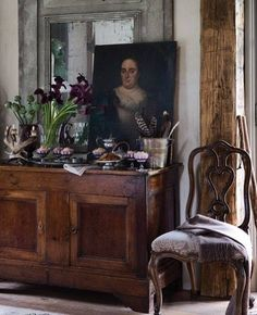 . sideboard (or chest?) & ART - with the perfect choice of floral deep, lush color / Designer?