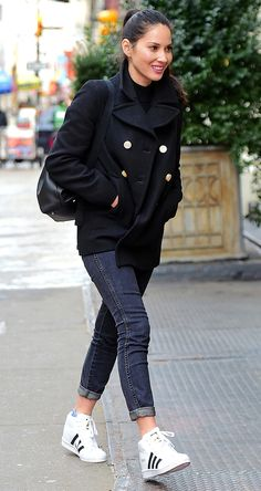 Olivia Munn in a black peacoat, jeans and Adidas sneakers - click through for more winter outfit ideas from celebrities
