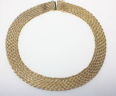 Gleichlaufendes, goldenes Geflechtcollier 750/f gest., ca. 17,7 mm breit, 42,5 cm lang, neuwertig.Br