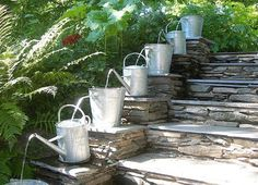 garden decoration ideas creative water cascade old water cans stone stairs