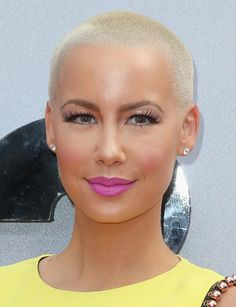 Only Amber Rose can pulled out a bold buzz cut, paired with fuchsia lips and lushious lashes on BET Awards 2013.