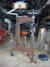"English Wheel by Howard Connelly Design -- Made this english wheel with dentist light, pull out stool, sand bag stand, forming dollies stand, and re-machined Horrible Freight wheels w/ new bearings. The aluminum pack-packs called ""Screamers"" were my first..."
