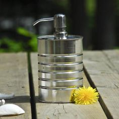 How to Make a Tin Can Soap Dispenser {trash to treasure}- need to check this out, curious if they drill a hole and then drain the can? Going to bed and checking tomorrow. Pot A Crayon, Diy Cans, Tin Can Crafts, Aluminum Cans, Soap Pump, Soap Dispensers, Jam Jar, Trash To Treasure, Do It Yourself Home