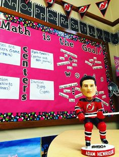 Sports theme classroom; math centers/word wall. Go Devils! Adam Henrique bobble head is a great addition to the hockey wall!