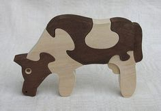 wooden cow puzzle - I had one of these as a kid! Only mine was more amazing, all the black cow spots were removable pieces! Wooden Puzzles, Wooden Blocks, Wood Projects, Woodworking Projects, Animal Templates, How To Make Toys, Intarsia Woodworking, Scroll Saw Patterns, Puzzle Toys