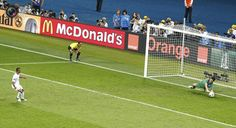 Italy's goalkeeper Buffon makes a save from England's Cole during the penalty shoot-out at their Euro 2012 quarter-final soccer match at the Olympic stadium in Kiev. MICHAEL DALDER/REUTERS
