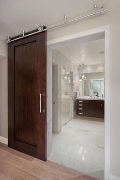 in a playful design move the elegant wood door to this stunning bathroom slides back