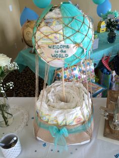 Hot air balloon diaper cake, baby shower, decorations, baby boy, explorer theme, welcome to the world Baby Shower Balloons, Baby Shower Games, Baby Boy Shower, Dr Seuss Baby Shower, Baby Shower Prizes, Diaper Cake Basket, Diaper Cakes, Baby Shower Gender Reveal, Baby Shower Decorations