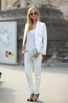 Dress up your jeans and t-shirt routine for the office with a pinstriped summer blazer a la blogger Pernille.   - HarpersBAZAAR.com