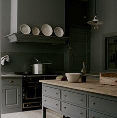 plain english kitchen | color - wood island counter - black appliances
