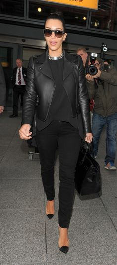 Black on black + leather coat + tucked tee + denim jean + louboutin see thru pump + black birkin bag