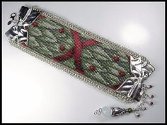 The ribbon design, in this Christmas Cuff of tied Holly and Berries, was continued not only in the bead loomed pattern but also for the clasp.