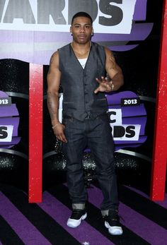 Did Nelly forget his shirt for the CMT Awards?