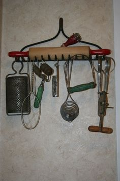 Get those old kitchen utensils out of the drawer! What a unique and inexpensive way to display those old kitchen utensils you've been collecting. Old Kitchen, Kitchen Items, Kitchen Gadgets, Kitchen Utensils, Kitchen Tools, Antique Kitchen Decor, Antique Decor, Cooking Utensils, Old Farmhouse Kitchen