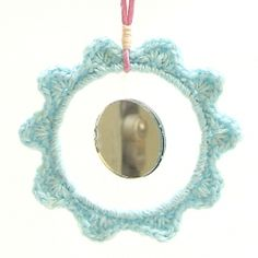 DIY Crocheted ornament. I am thinking this would be great if you put a picture or a significant date in the center instead of a mirror.