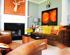 Brown couch with orange and yellow