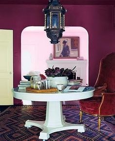 Deep Plum walls and love those rugs