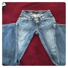 BEAUTIFUL LEVI'S 524 JEANS. These have some stretch to them. Faded front and behind and in great condition. Light wash jeans. Levi's Jeans Boot Cut