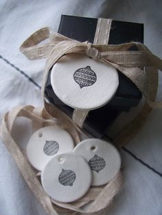 They have been made with white ceramic clay (not air dry clay or salt dough), rolled on linen and stamped with a little Christmas bauble image in black and comes in a set of 4.  Due to the nature of the clay and hand stamping there will be slight variances in each tag.  Tag size is 4.5cm across.