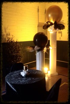 Black and gold balloons with feathers on columns , Gatsby theme party.