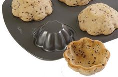 Turn your muffin pan upside down, bake cookie-dough over the top and voilà  – you have cookie bowls for fruit or ice-cream.  I would use prepared cookie dough or packaged cookie mix.