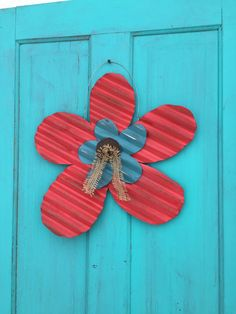These large rustic flowers can be used as a door hanging, or a colorful addition to your garden!  They are cut from galvanized corrugated tin. All flowers are prehung, ready to go!    Options available are red with a small turquoise flower in the center, pink with a small purple flower, pink with a small turquoise flower, purple with  A small turquoise flower, and turquoise with either pink or purple in the center. I only have a couple in each color, I will try to remove the options that…