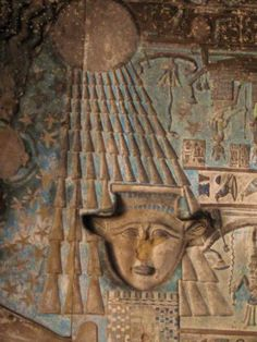 Dendera Part of one of the vertical zodiacs  in the hypostyle hall. (Hathor face in the shape for the hieroglyph for heart (sacred heart))