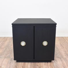 This shabby chic end table cabinet is featured in a solid wood with a black matte paint finish. This side table is in great condition with 2 doors, a large interior cabinet and carved white gold handles. Perfect as a nightstand with interior storage! #shabbychic #tables #endtable #sandiegovintage #vintagefurniture