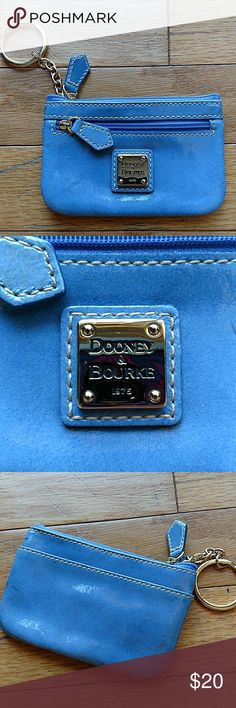 Dooney and Bourke Coin Purse Patent leather Dooney and Bourke Coin Purse Been used Has some dark spots on the side Pretty blue color Dooney & Bourke Bags Wallets