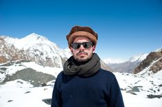 Khunu Ambassador, James D. Poborsa, at the base of Mount Noshaq (roughly 4500m), wearing a Khunu scarf, and surrounded by four majestic peaks over 7000m.