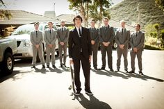 Groom in black, groomsmen in grey. Lucas so needs to do this with the skateboard!