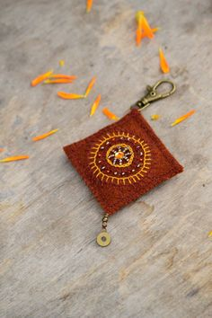 Rustic orange textile key chain with handmade embroidery by Mioltu