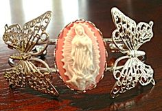 $69 Silvertone metal bracelet with 2 large filigree butterflies and a center pink and white cameo depicting Our Lady of Guadalupe. The butterfli...