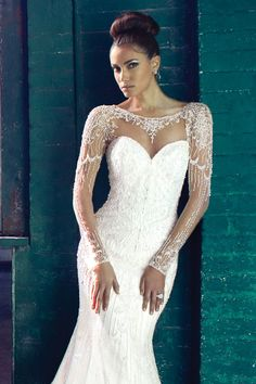 Justin Alexander Signature wedding dress with glamorous beaded illusion sleeves and neckline.