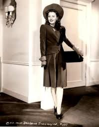Barbara Stanwyck. Love the hat as well as the suit!