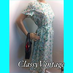 Bundled and sold Fun vintage daydress. The fabric is acetate and quite sheer. Back zipper and a tie belt. Round neckline and short sleeves. Hand made. Bust 40 waist 38 - hips 45 and length 42 inches. No flaws - the belt is 56 inches. Vg14 vintage Dresses