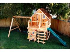 Very nice play structure with cabin and rock climbing wall.