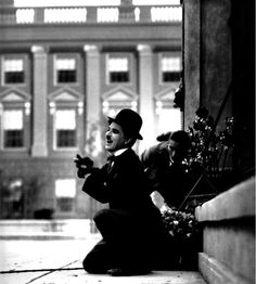 Chaplin on the set of CITY LIGHTS. Cameraman Rollie Totheroh lines up the shot behind him.