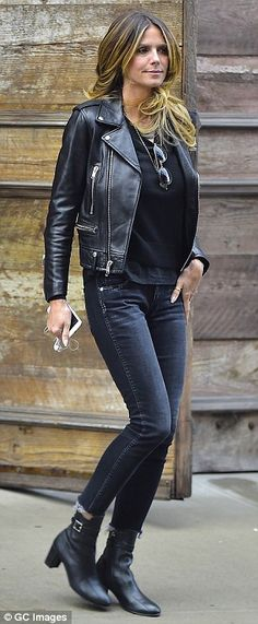 All leathered up: The 43-year-old got herself a cup of coffee in a pair of black leather b...