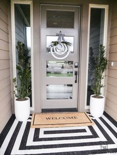 Modern Spring Porch Decor - Floor Plants - Ideas of Floor Plants - Get your porch ready for spring! Taryn shares her tips for decorating a front porch and reveals her modern spring porch decor! The black and white outdoor rug makes such a statement! Front Door Entrance, Front Door Decor, Front Doors, Front Porch Decorations, Planters For Front Porch, Front Door Plants, Small Front Porches, Doorway, Building A Porch
