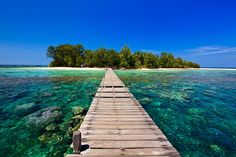 Crystal clear waters and colourful coral reefs around the small island of Pulau Kecil, located within the Marine National Park of Karimunjawa or Karimun Jawa, which translates as a stone's throw from Java.