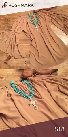 Tan Tunic Tunic • Never worn • Perfect condition • Tag says medium but comfortably fits size large • Great paired with skinny jeans and boots Tops Tunics