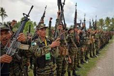 Image copyright                  AFP                                                                          Image caption                                      The MILF has signed a peace agreement with the government to give up arms, but several splinter factions have refused to accede                                More than 150 inmates escaped from a prison