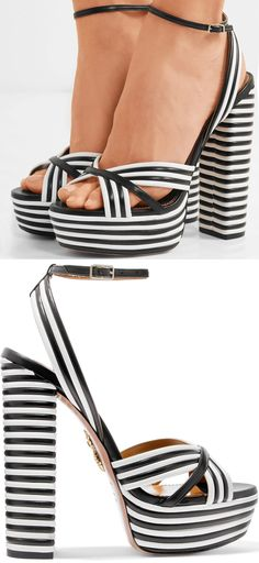 Aquazzura's 'Sundance' sandals match the black and white striped archways in the brand's newest store on New York City's Madison Avenue. This chunky pair has been meticulously made in Italy from laminated leather and sits on a 150mm heel with a 40mm platform.