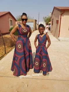 Mommy and Daughter in Ankara Maxi Dresses. But with a better fitting cut on the daughter dress Ankara Maxi Dress, African Maxi Dresses, Shweshwe Dresses, African Attire, African Wear, African Women, African Style, African American Fashion, African Inspired Fashion