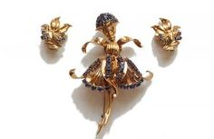 """""""John Rubel's jewels have always danced. My wish today is that they resume their ballet of shapes and colors"""", says Sophie Mizrahi-Rubel, granddaughter and president of John Rubel Paris. It was in a famous nightclub that John Rubel scribbled the design for the ballerina brooch on a napkin. . The brooch is part of a demi-parure with a pair of earrings set in 18K gold and sapphires."""