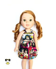 Cute and fun in this trendy Wonder Woman spaghetti strap doll dress, perfect for Wellie Wishers! The dress features a purple, yellow, red and white Wonder Woman print with spaghetti straps and a Velcro closure. Item was handcrafted in our pet free, smoke free sewing studio. • Listing