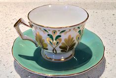 This Aynsley tea cup set is in a rare and stunning shade of mid century mint green. There is no colour or gold loss, no chips cracks or crazing visible. Excellent and unique gift for Mother's Day, birthday or to add a special piece to your own collection. Ship international, message
