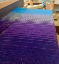 On the loom, Fibonacci warp design with 4 family colours.