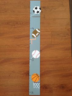DIY sport theme growth chart. All supplies were found at Michaels. Total cost about $4.